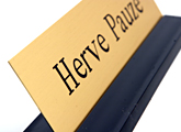 Your brass desk nameplates are held upright with the solid black nameplate base.